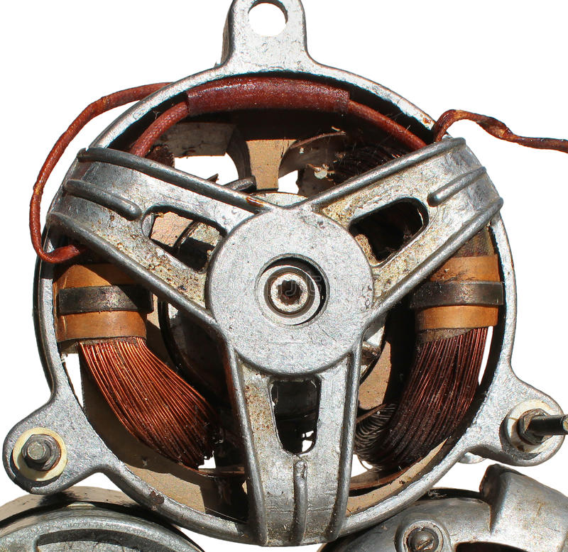 Old electric motor closeup, isolated on white background stock photos