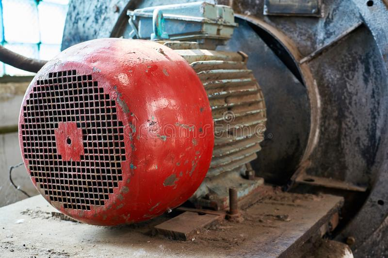 Old electric motor with cold water pump. Industrial background stock photography