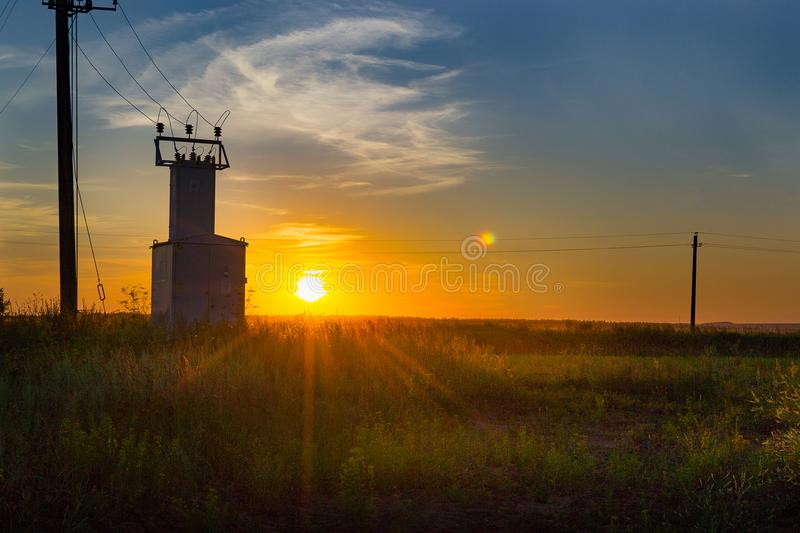 Old electric shield, high voltage switch in the field at sunset royalty free stock photography