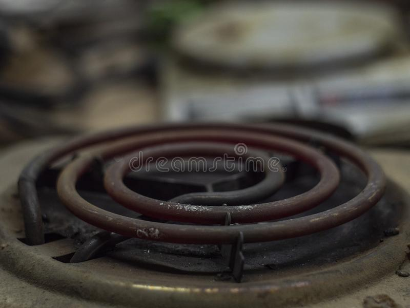 Old electric stove. electric burner on stove. hot faded spirals of an old electric stove stock photos