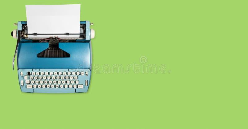 Old electric typewriter on plain background stock photo