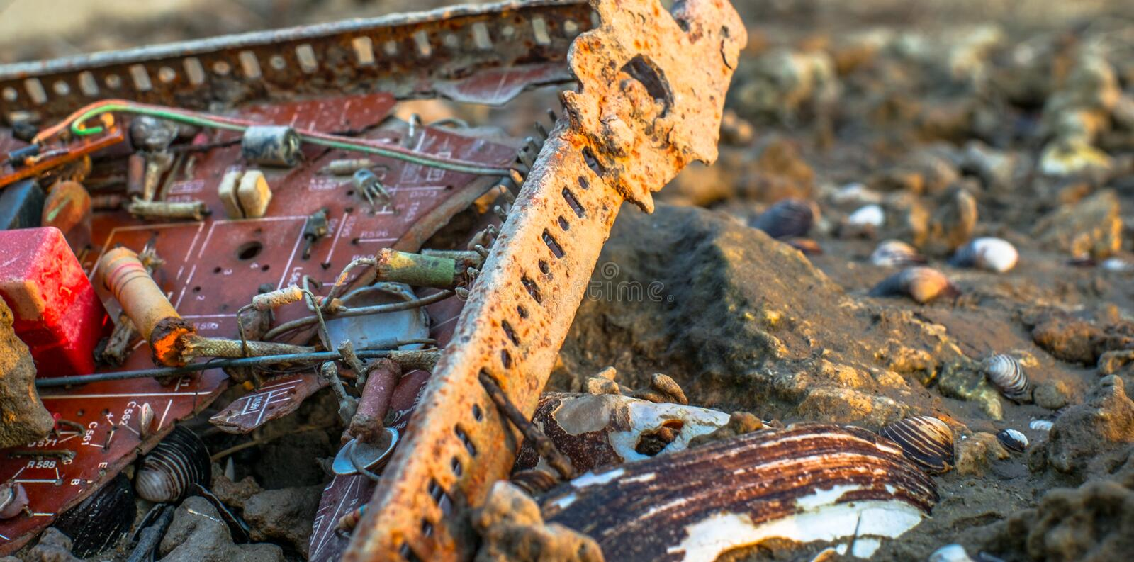 Old electronic circuit found on beach. Close up stock photos