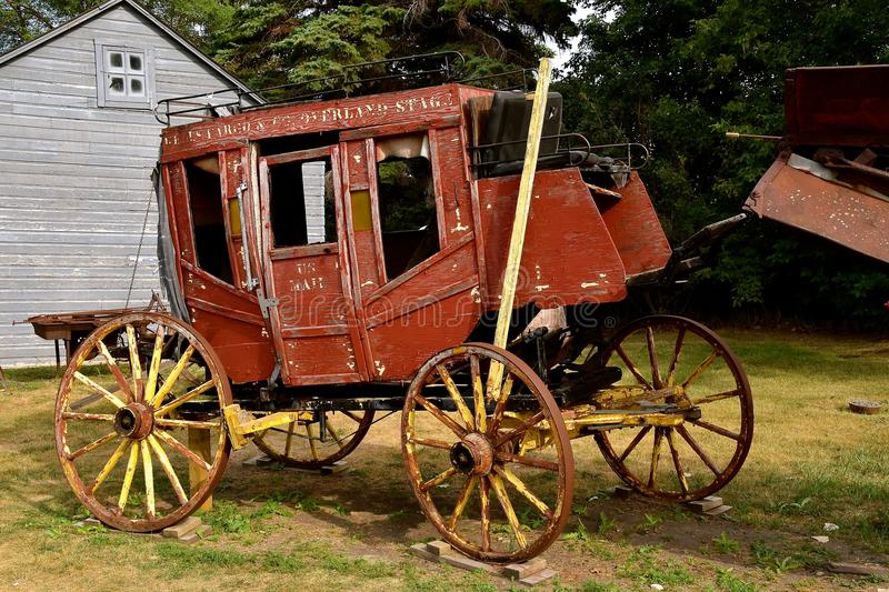 Old Wells Fargo Stagecoach. JAMESTOWN, NORTH DAKOTA, July 26, 2017: The old rickety Wells Fargo stagecoach is a product of the Wells Fargo Co. founded 170 years stock photo