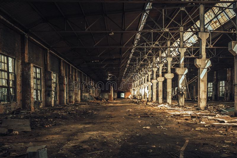 Old empty abandoned and ruined factory hall or warehouse inside interior stock photos