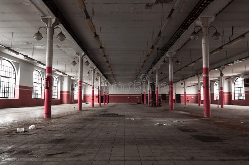 An old empty industrial warehouse interior stock image