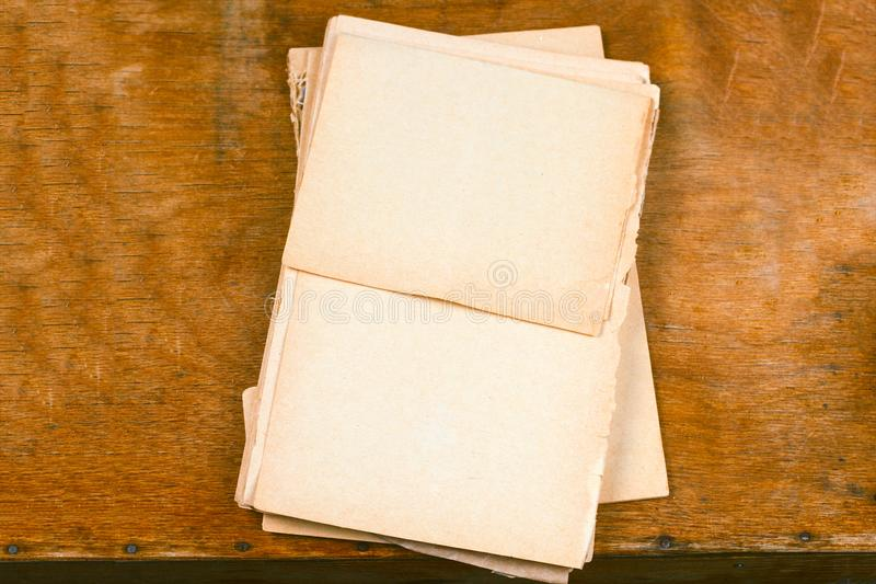 Old empty paper sheets. Top view wooden table royalty free stock photo