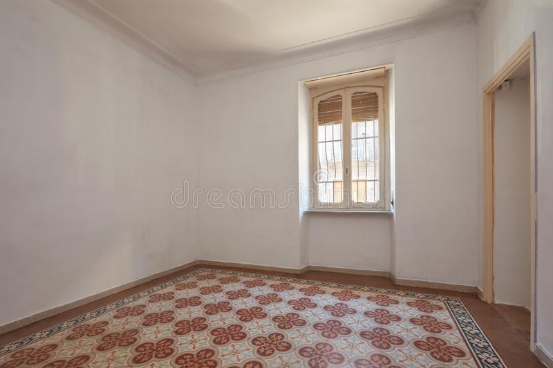 Old, empty room interior with tiled, decorated floor stock images