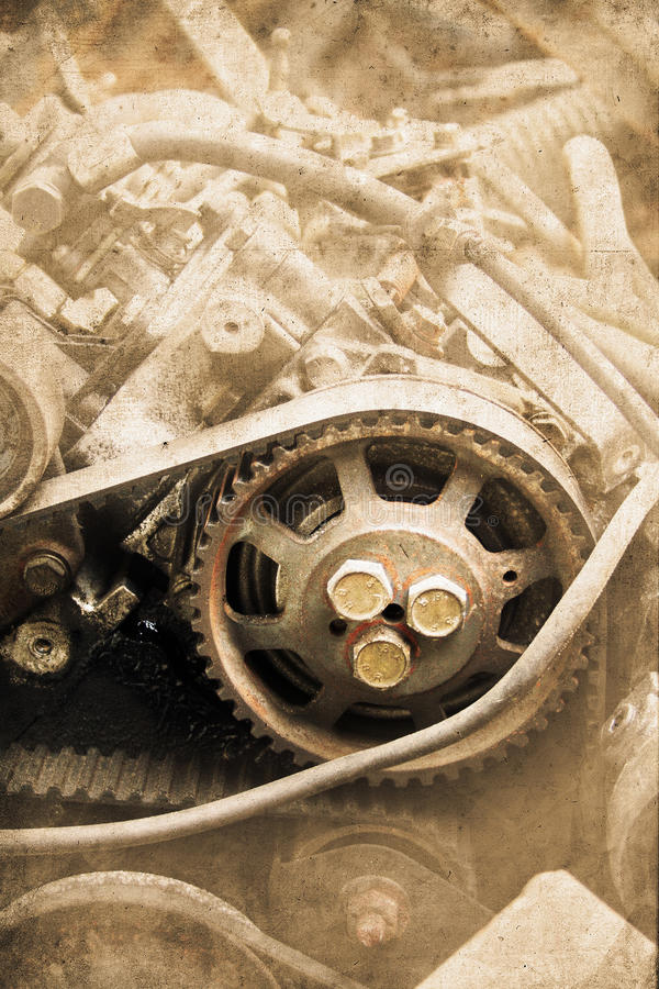 Old engine. Old construction equipment - engine with cog wheels stock photography