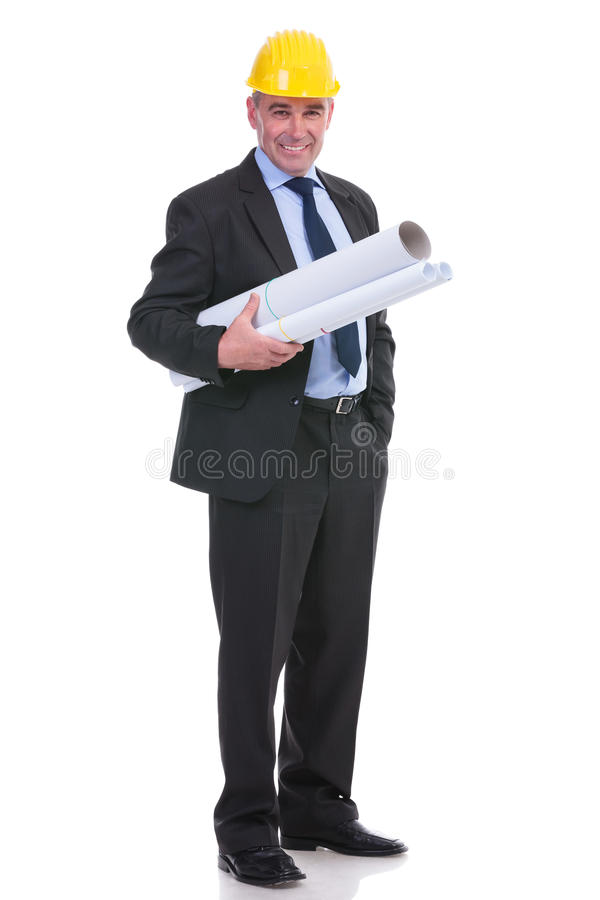 Old engineer with blueprints stock image