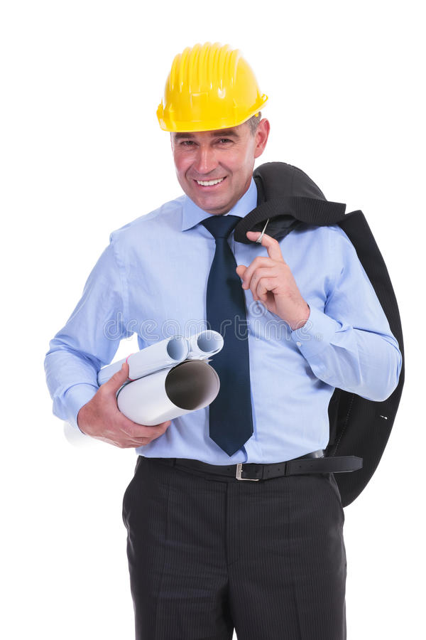 Old engineer holds projects and jacket. Senior engineer holding some projects in a hand and his suit jacket in the other while smiling to the camera. isolated on stock image
