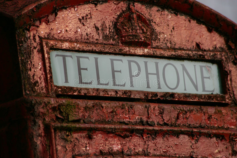Old English phone box. Detail of an weathered english phone box. Picture was taken in in England, Cornwall royalty free stock photos