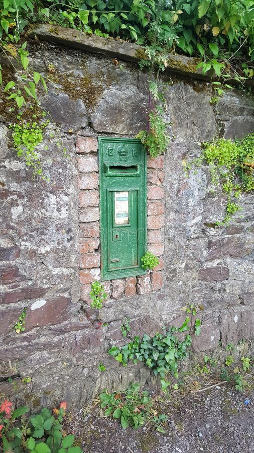 Old English post box in Ireland. King Edward VII post box. Installed between 1901 and 1910 in Rochestown Ireland near Rochestown Inn. Still in operation and stock photo