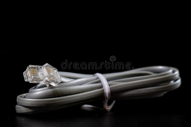 Old entangled cables, electronics and old cable connectors on a royalty free stock images