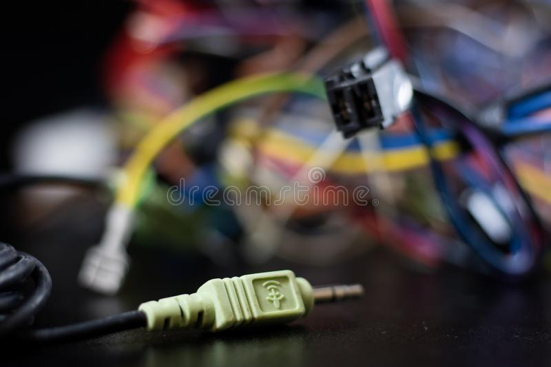 Old entangled cables, electronics and old cable connectors on a royalty free stock photos