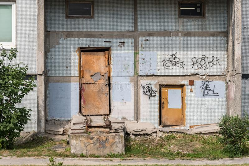 Old entrance doors to residential building royalty free stock image
