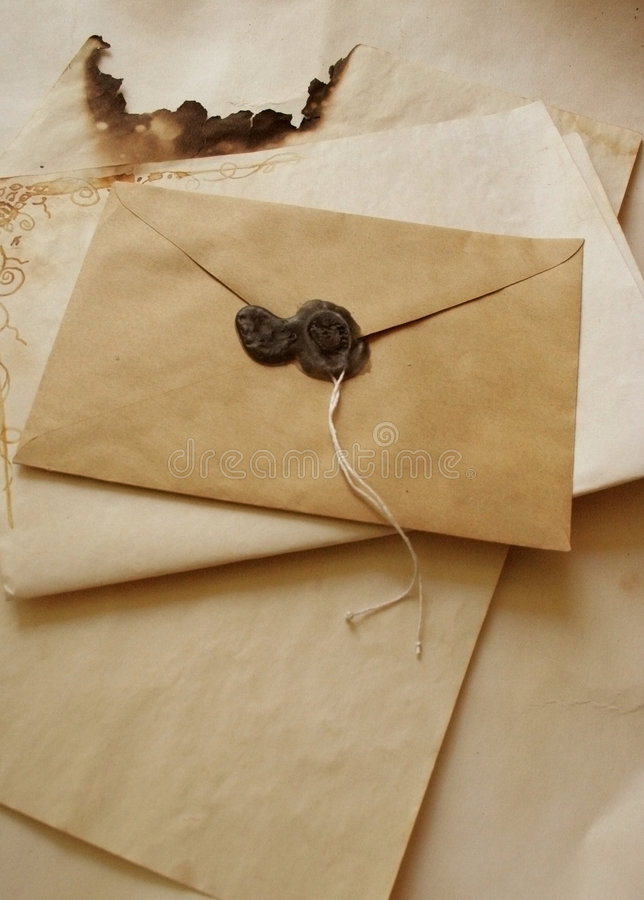 Old envelope. An old envelope with seal and burnt paper