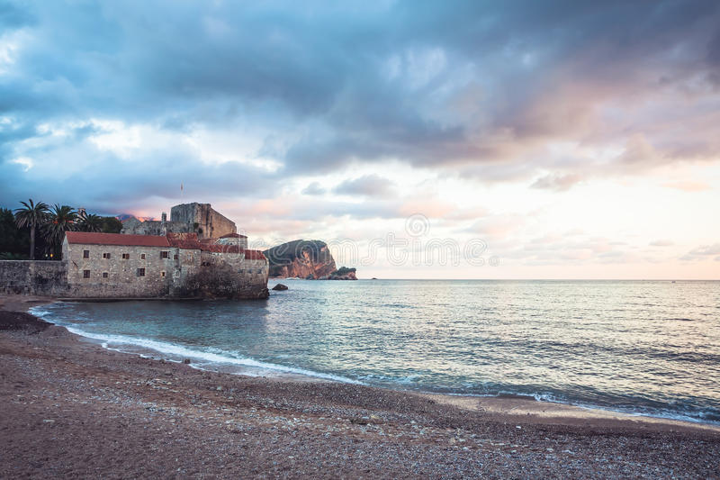 Old European sea fortress during beautiful sunset on Montenegro seashore. Old European sea fort during beautiful sunset on Montenegro seashore stock images