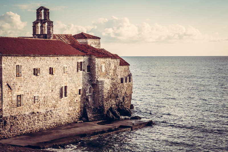 Old European sea fortress at sunset in European country Montenegro. Old European sea fort at sunset in European country Montenegro royalty free stock photography