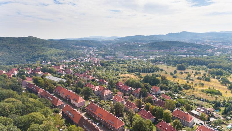 Old European town with green hills drone view from above. Old European town with red roof buildings and green hills drone view from above stock photo