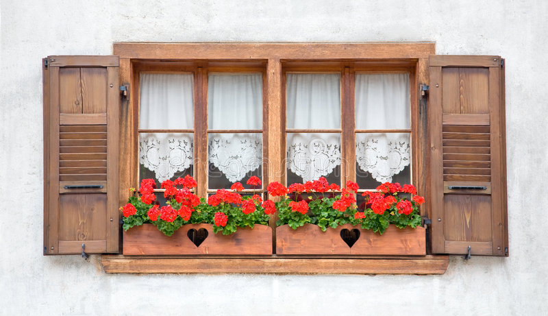 Old European Wooden Windows. With shutters and flowers stock photos