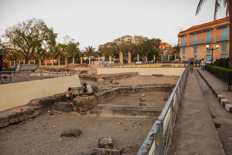 Old excavations in the city center near the beautiful building. Havana. Cuba stock photos