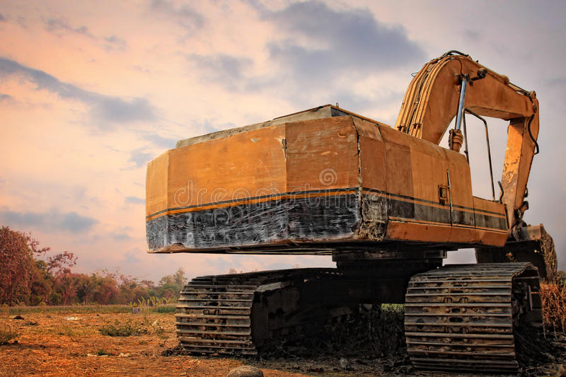 Old excavator on a field stock photo