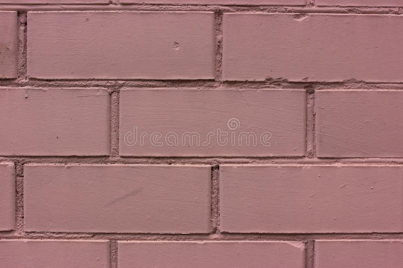 Pink painted brick wall. Monochrome royalty free stock image