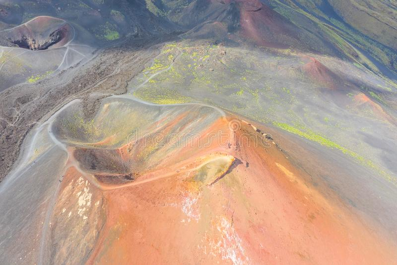 Old extinct inactive craters on the slope of the volcano Etna with tourist trails, aerial top view.  stock photos