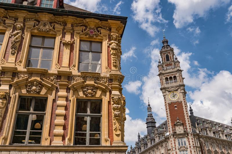Old facade ans Belfry of the Chambre de Commerce. Lille, France - 15 June 2018: Old facade ans Belfry of the Chambre de Commerce royalty free stock photography