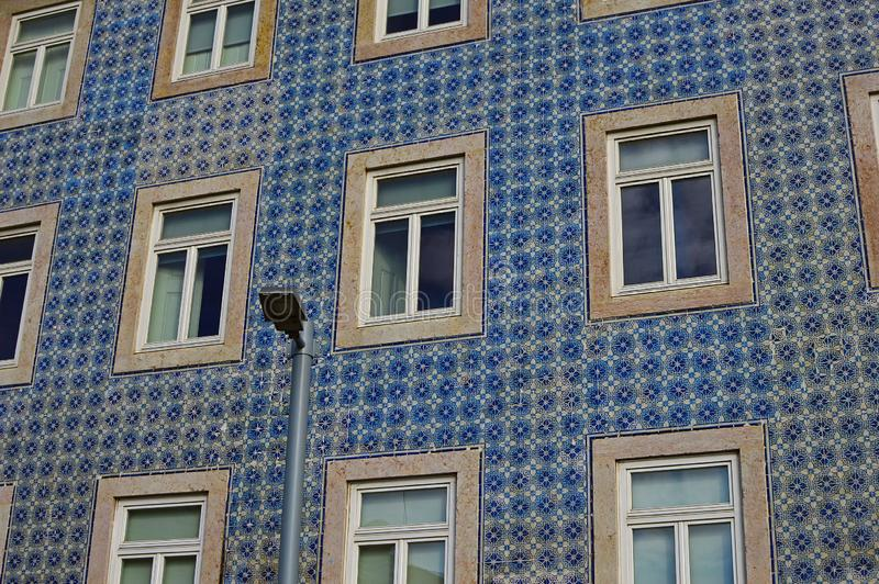 The old facade of the building is covered with azulejo ceramic t. Ile. Lisbon, Portugal stock photography