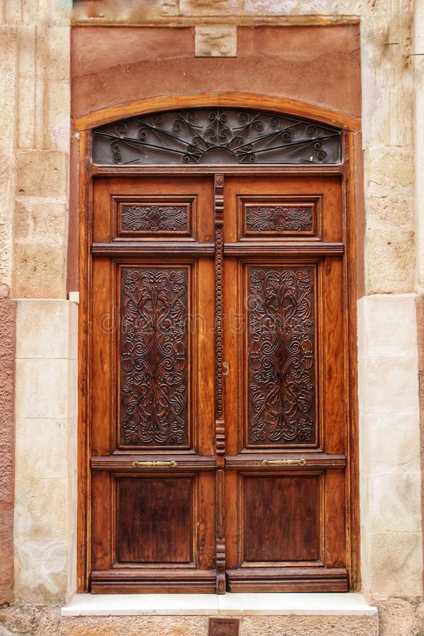 Old facade and entrance of majestic house in Alcaraz, Albacete province, Spain. Old stone facade made of carved stone and vintage wooden door in a majestic house royalty free stock photo