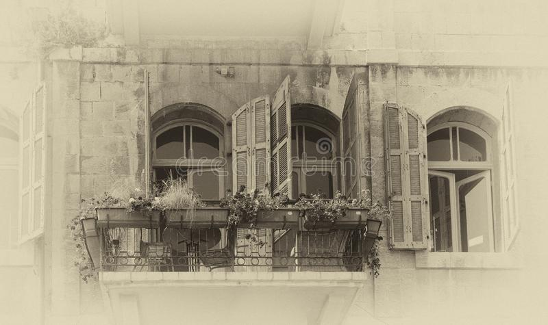 Old Facade of windows and door in Jaffa Israel. An old black and white facade in the flea market of Jaffa Israel stock images