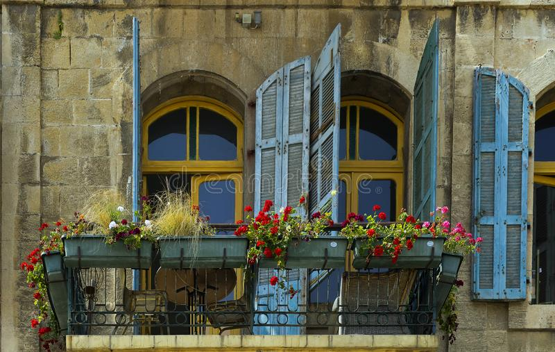 Old Facade of windows and door in Jaffa Israel. An old colorful facade in the flea market of Jaffa Israel stock image