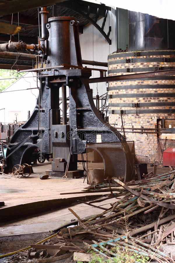 Old factory D. Photograph of a large press inside an old factory stock image