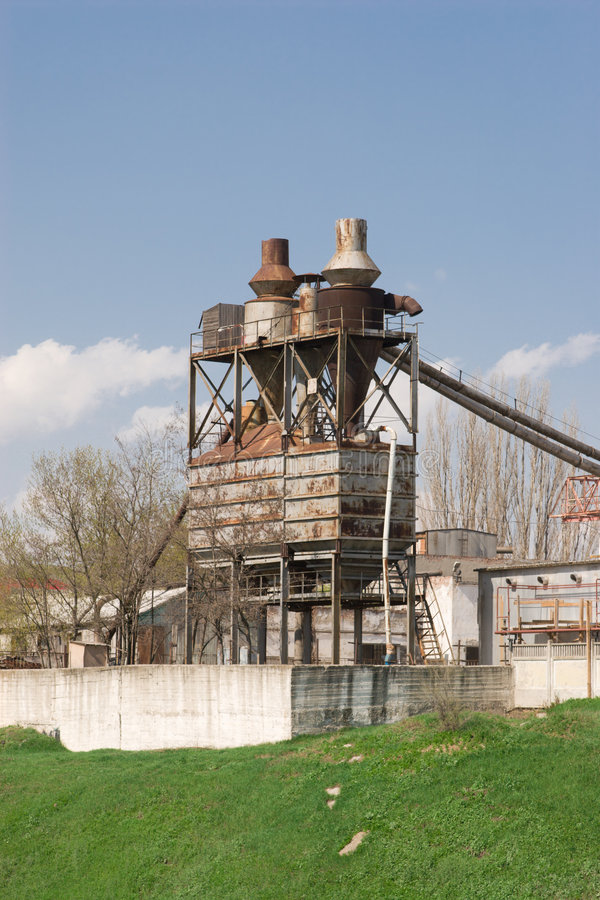 Old factory on a green hill royalty free stock photo
