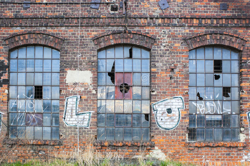 Old factory windows. Old factory break windows in commercial area stock photo
