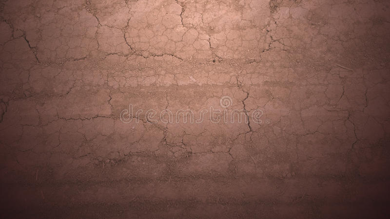 Old faded dirt road_2. Dusty dry cracked earth. Old faded dirt road. Car trails at the bottom royalty free stock photo