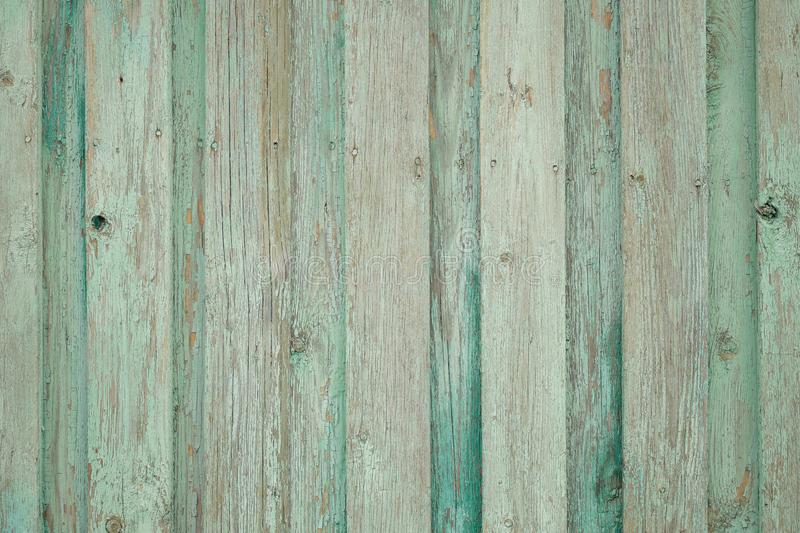 Background old wooden fence. Green background. royalty free stock photo