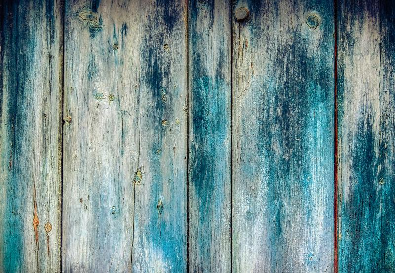 Old faded paint on wooden boards royalty free stock photography
