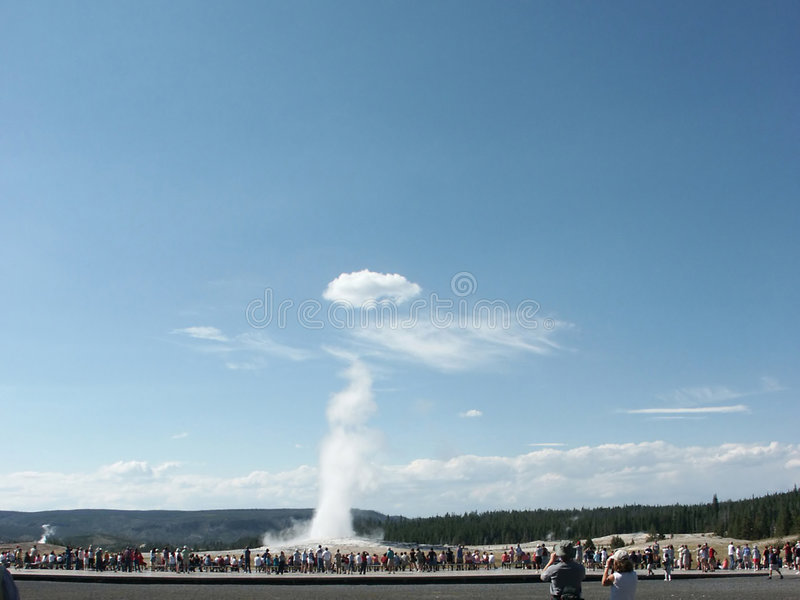 Old Faithful with Wings. For a few seconds in July 2003 the clouds over Old Faithful geyser gave it the magical appearance of a celestial figure royalty free stock photography