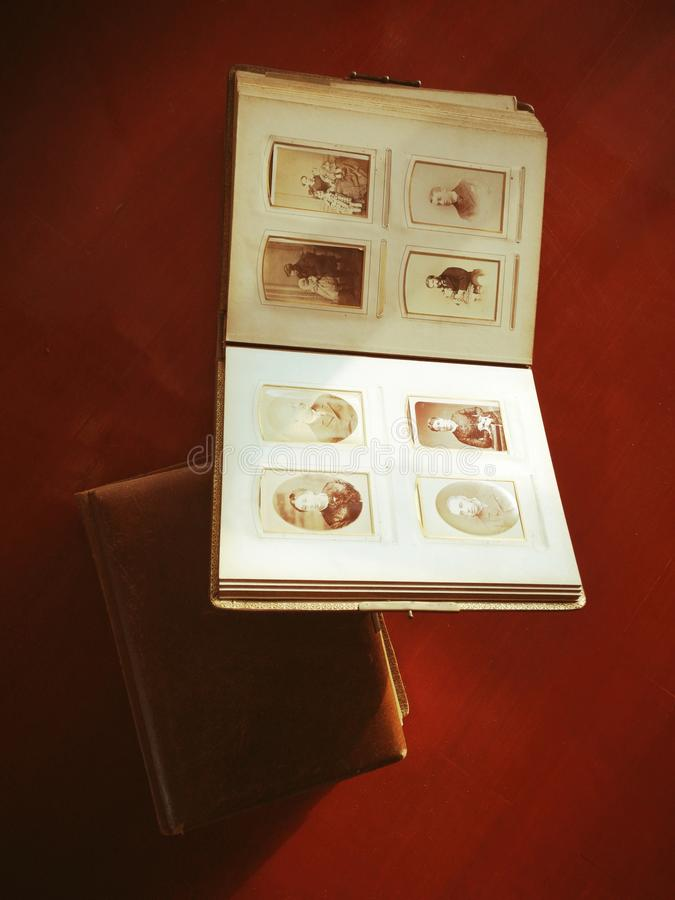 Old family book with vintage photography, nostalgia of past times stock photography