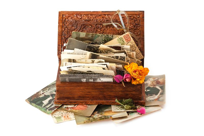 Old family photos. Stacked in wooden box isolated on white background royalty free stock images