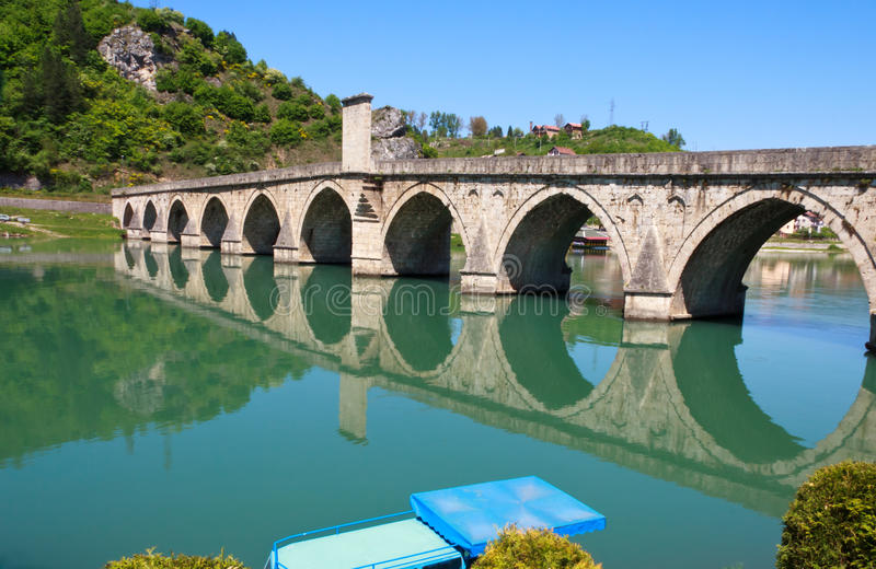 Old,Famous bridge on the Drina in Visegrad, Bosnia. Famous bridge on the Drina in Visegrad, Bosnia and Herzegovina, on a hot summer day stock image