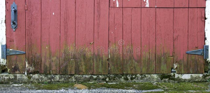 Old Farm Barn Wood Door Panorama Panoramic, Banner. An actual Wisconsin dairy farm barn door is presented in a panorama, panoramic, or banner format. The bottom stock photo