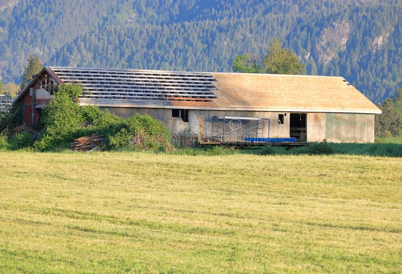 Old Farm Building Gets New Roof. An old barn or livestock building is getting a new roof and will be used for many more years stock image