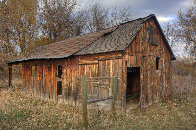 Old farm building in late fall scenery royalty free stock images