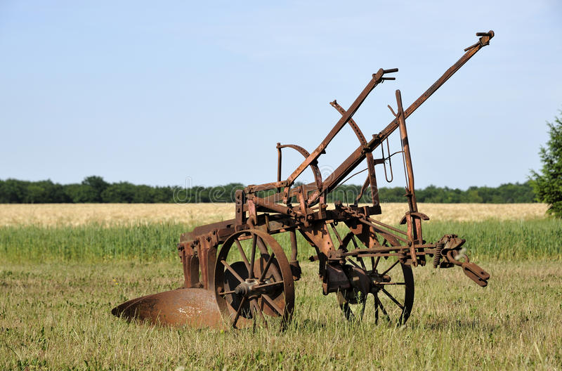 Old farm equipment stock photography