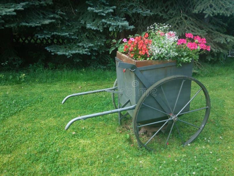 Old farm retro flower wagon royalty free stock photography