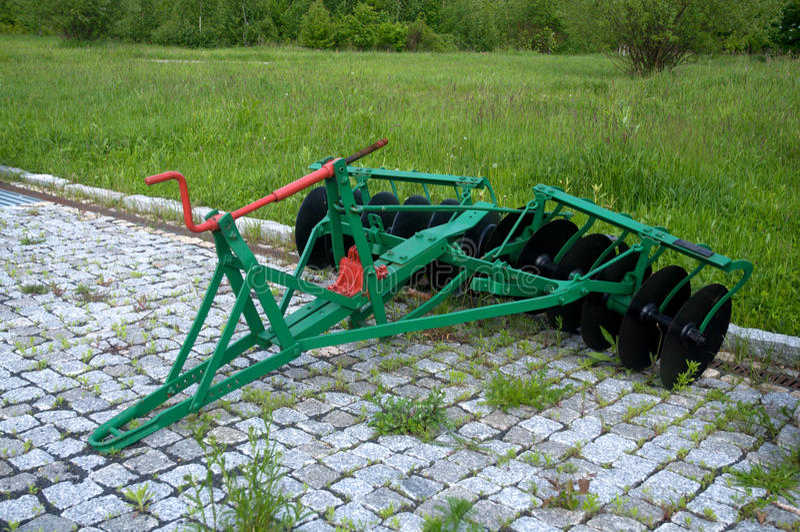Old farm tiller. stock images