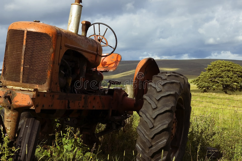 Old farm tractor stock photo